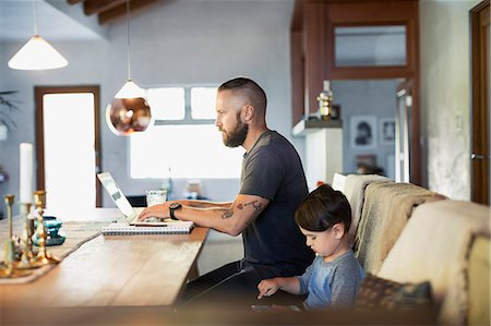 father with two sons not girls - Side view of father and son using technologies at dining table Stock Photo - Premium Royalty-Free, Code: 698-08226846