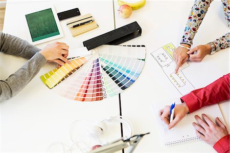 designer - Cropped image of business people working on color swatches at desk in creative office Stock Photo - Premium Royalty-Free, Code: 698-08226860