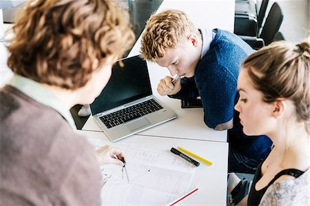 High angle view of students and professor in classroom Stock Photo - Premium Royalty-Free, Code: 698-08330581