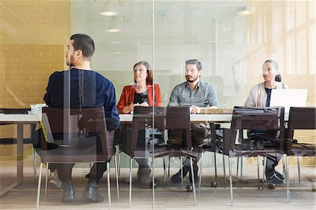 Multi-ethnic business people in office meeting Stock Photo - Premium Royalty-Free, Code: 698-08331143