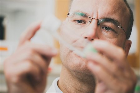 Male scientist examining sample in test tube at laboratory Stock Photo - Premium Royalty-Free, Code: 698-08392949