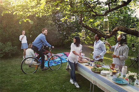 Multi-ethnic friends enjoying summer party in backyard Stock Photo - Premium Royalty-Free, Code: 698-08392996