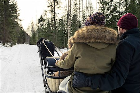 Rear view of people enjoying horse-drawn sled ride Stock Photo - Premium Royalty-Free, Code: 698-08393363