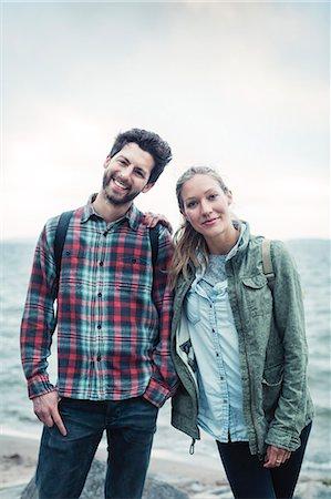 friluftsliv - Portrait of happy wonderlust couple standing on beach Stock Photo - Premium Royalty-Free, Code: 698-08393463