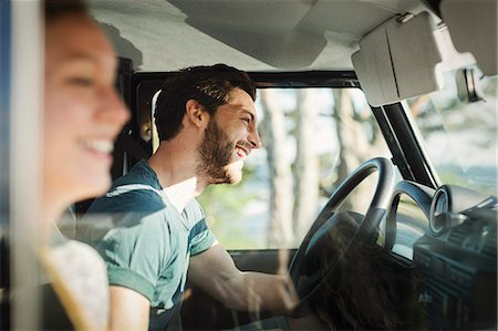 Side view of happy couple enjoying road trip Stock Photo - Premium Royalty-Free, Code: 698-08393515