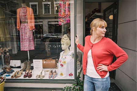 small business - Confident owner standing against store looking away with hand on hip Stock Photo - Premium Royalty-Free, Code: 698-08434488