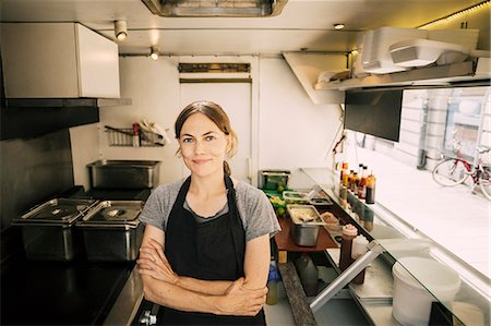 restaurant - Portrait of confident female chef in food truck Stock Photo - Premium Royalty-Free, Code: 698-08434568
