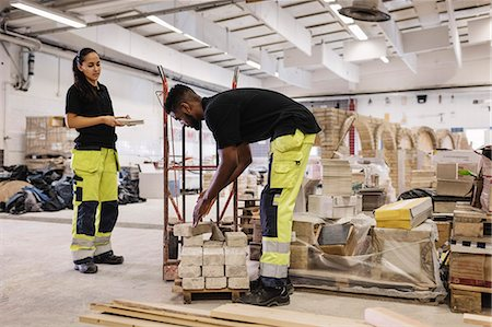 Carpentry students working at site Stock Photo - Premium Royalty-Free, Code: 698-08545087