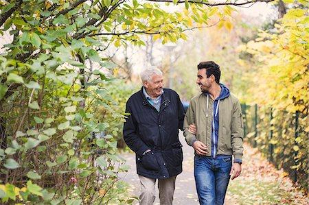 Happy senior man with caretaker walking in park Stock Photo - Premium Royalty-Free, Code: 698-08545212