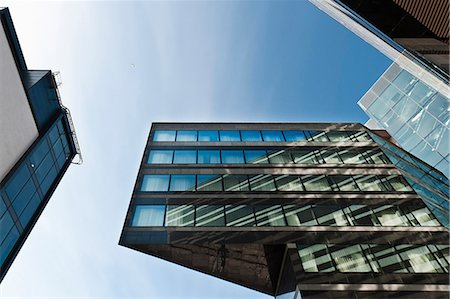 Low angle view of office building Stock Photo - Premium Royalty-Free, Code: 698-08545398