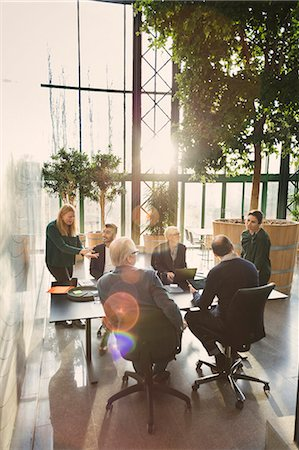 Team of business people discussing at table in creative office Stock Photo - Premium Royalty-Free, Code: 698-08545442