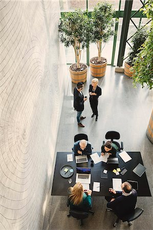 High angle view of business people working in creative office Stock Photo - Premium Royalty-Free, Code: 698-08545482