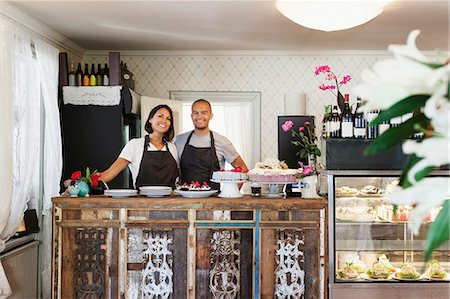 fresh - Portrait of smiling bakers standing at cafe counter Stock Photo - Premium Royalty-Free, Code: 698-08685577