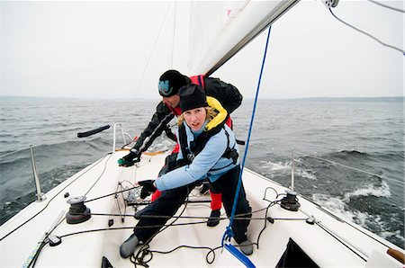 sports and sailing - Crew wrapping lines around crank Stock Photo - Premium Royalty-Free, Code: 698-03656758