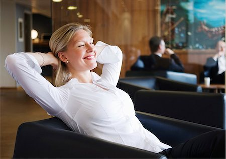 Woman relaxing in armchair Stock Photo - Premium Royalty-Free, Code: 698-03657248
