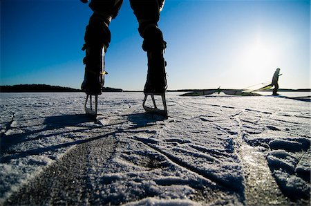 sports and sailing - Two people ice skating Stock Photo - Premium Royalty-Free, Code: 698-03657294