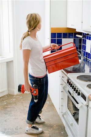 Woman putting toolbox on bench Stock Photo - Premium Royalty-Free, Code: 698-03657524