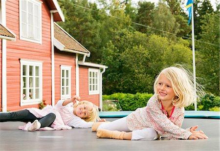 pantyhose kid - Two sisters lying on rebouncer Stock Photo - Premium Royalty-Free, Code: 698-03657895