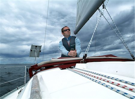 sailing boat storm - Man on sailboat Stock Photo - Premium Royalty-Free, Code: 698-03669847