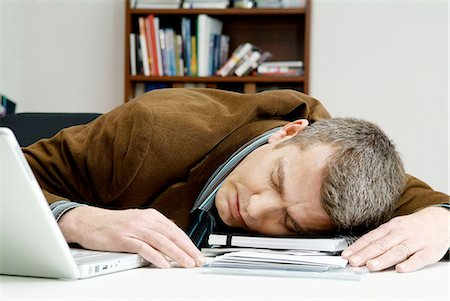 drunk passed out - Man has fallen asleep on the desk Stock Photo - Premium Royalty-Free, Code: 698-03670014