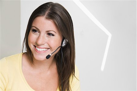 Happy girl with headset Stock Photo - Premium Royalty-Free, Code: 698-03671315