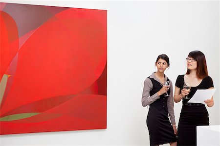 exhibition - Young women looking at wall painting in art gallery Stock Photo - Premium Royalty-Free, Code: 693-05552744