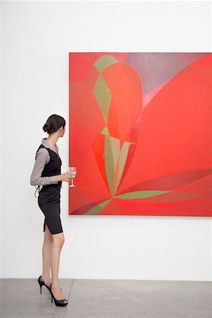 exhibition - Full length of a woman looking at painting in art gallery Stock Photo - Premium Royalty-Free, Code: 693-05552741