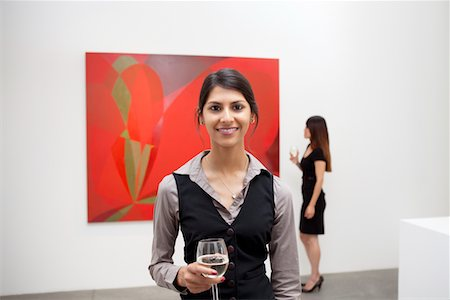 exhibition - Portrait of young woman in front of painting in art gallery Stock Photo - Premium Royalty-Free, Code: 693-05552742