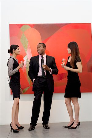 exhibition - Young executives having a conversation in front of painting in art gallery Stock Photo - Premium Royalty-Free, Code: 693-05552752