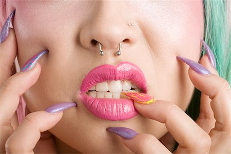 Close-up of a woman's mouth and fingers Stock Photo - Premium Royalty-Free, Code: 693-05552793