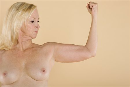 Naked woman flexing her muscles Stock Photo - Premium Royalty-Free, Code: 693-05552857