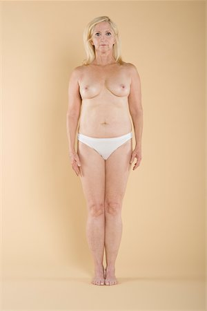 Full length of a topless woman standing Stock Photo - Premium Royalty-Free, Code: 693-05552858