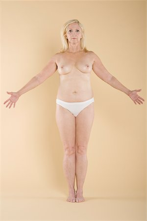 Woman exposing her breasts Stock Photo - Premium Royalty-Free, Code: 693-05552859