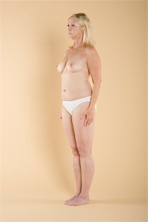 Full length of a woman standing topless Stock Photo - Premium Royalty-Free, Code: 693-05552860