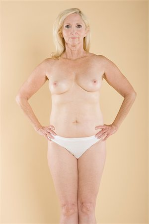 Portrait of a middle aged woman with exposed body Stock Photo - Premium Royalty-Free, Code: 693-05552862