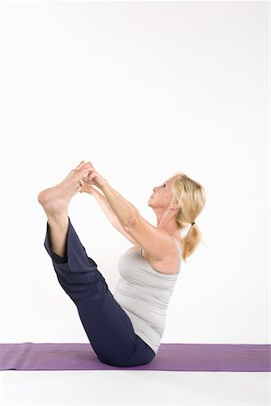 fitness   mature woman - Side view of a woman doing yoga Stock Photo - Premium Royalty-Free, Code: 693-05552882