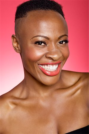 Portrait of cheerful African American woman Stock Photo - Premium Royalty-Free, Code: 693-05552899