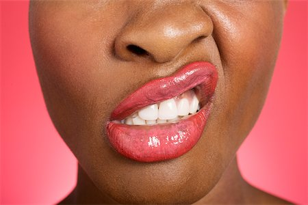 Close up of woman making a face Stock Photo - Premium Royalty-Free, Code: 693-05552900