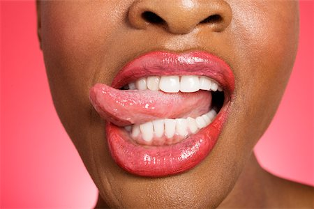 Close up of woman sticking out tongue Stock Photo - Premium Royalty-Free, Code: 693-05552901