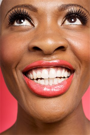 Close up of cheerful woman looking up Stock Photo - Premium Royalty-Free, Code: 693-05552902