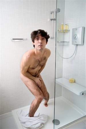 Scared naked man in bathroom Stock Photo - Premium Royalty-Free, Code: 693-05553204