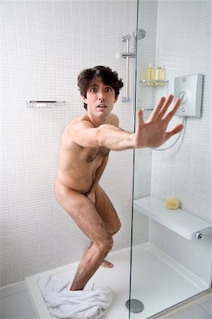 Young man caught naked in bathroom Stock Photo - Premium Royalty-Free, Code: 693-05553203