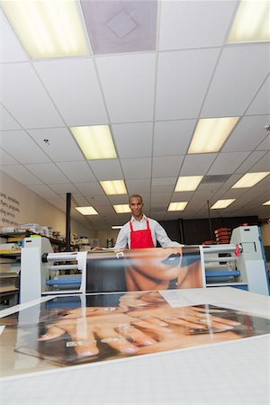 print - Worker taking printouts at printing press Stock Photo - Premium Royalty-Free, Code: 693-05794025