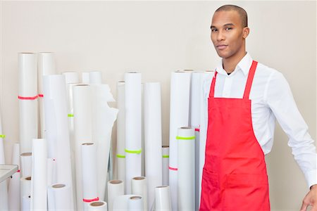 print - Portrait of printing press worker standing with paper rolls in background Stock Photo - Premium Royalty-Free, Code: 693-05794031