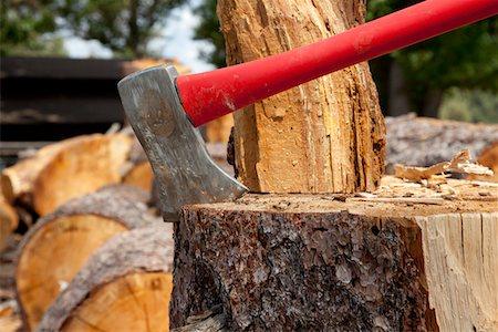 Axe wedged into tree stump Stock Photo - Premium Royalty-Free, Code: 693-05794373