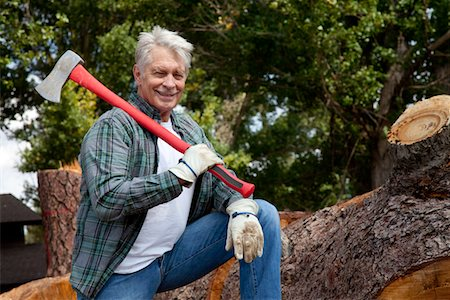 forestry - Portrait of lumberjack holding an axe Stock Photo - Premium Royalty-Free, Code: 693-05794386