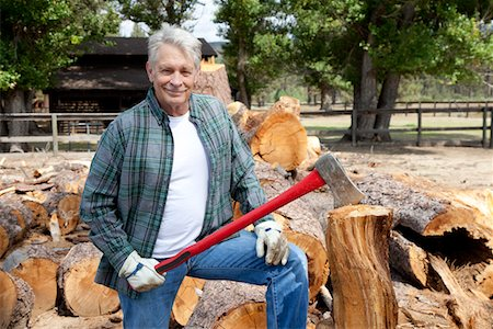 forestry - Portrait of senior lumber jack holding an axe Stock Photo - Premium Royalty-Free, Code: 693-05794380