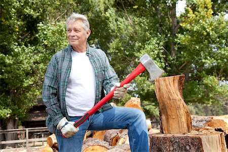 forestry - Senior lumber jack holding an axe and looking away Stock Photo - Premium Royalty-Free, Code: 693-05794381