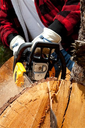 forestry - Close-up view of lumberjack with electric saw Stock Photo - Premium Royalty-Free, Code: 693-05794406