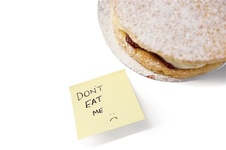 sugar - Piece of Victoria sponge cake with 'don't eat me' sign on sticky notepaper Stock Photo - Premium Royalty-Free, Code: 693-05794519